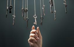 Hand reaching for key