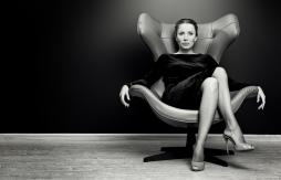 business woman seated confidently