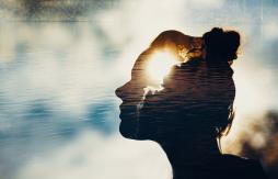 woman silhouette with universe superimposed on mind