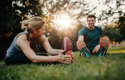 Two people exercising practising social distancing