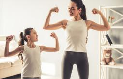 woman and her daughter exercising and staying strong together
